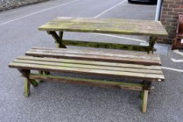 A teak garden table; together with a pair of bench seats.Collection of this lot is strictly by
