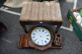 An antique carved dressing stool; together with an inlaid drop dial wall clock and an old suitcase.