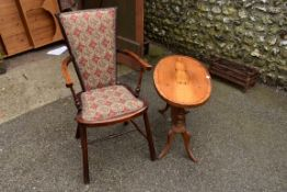 A reproduction yew wood oval occasional table; together with a beech elbow chair.Collection of