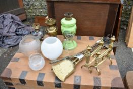 Three old oil lamps; together with a quantity of fire items.Collection of this lot is strictly by