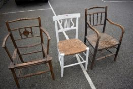 An antique oak rush seated chair and two others.Collection of this lot is strictly by appointment on