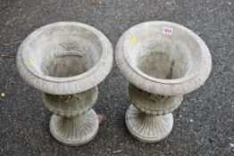 A pair of 'HGC' concrete pots, 46 high x 32cm wide.Collection of this lot is strictly by appointment