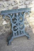 A pair of cast iron table supports, 66cm high x 68cm wide.Collection of this lot is strictly by
