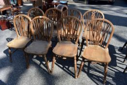 A set of eight oak dining chairs.Collection of this lot is strictly by appointment on Saturday