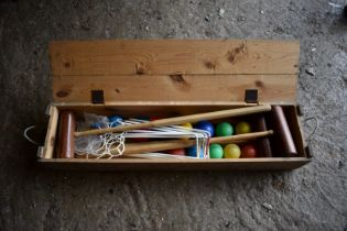 An old croquet set, in wooden box.