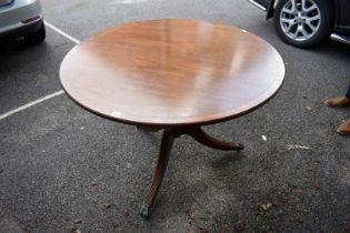 A reproduction mahogany and brass strung circular table, 100cm diameter.