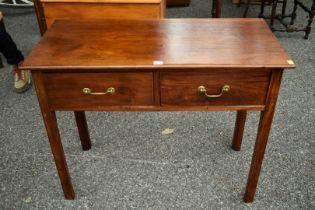 A mahogany two drawer side table, 97cm wide x 46cm deep x 76cm high.