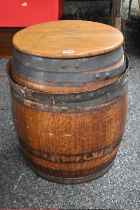 An old coopered oak barrel and cover.