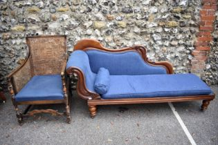 An antique chaise longue; together with a bergere armchair.