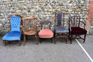 An antique mahogany nursing chair; together with a captains type chair and three others.