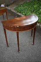 A George III mahogany, inlaid and crossbanded demi lune table.