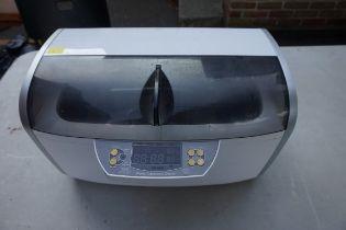 A digital ultrasonic cleaner.