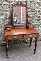 A circa 1900 mahogany mirror back dressing table, 91cm wide x 45cm deep x 145cm high.