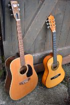 A Yasuma Jumbo 155 acoustic guitar; together with another acoustic guitar.