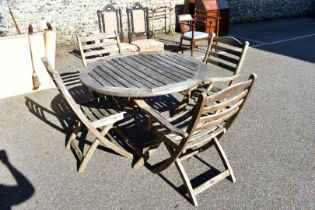 A teak garden table and four chairs by Alexander Rose.