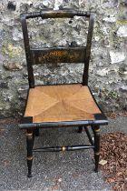 An ebonized cane seated chair, having gilt decoration.