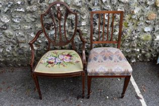 An Edwardian salon elbow chair; and another chair.