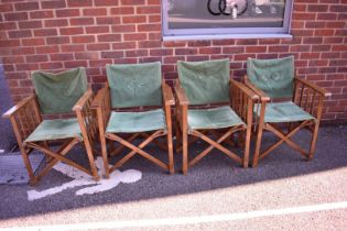 A set of four directors type chairs.