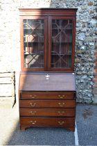 An Edwardian mahogany inlaid bureau bookcase, 91cm wide.