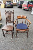 A circa 1880 carved oak chair; together with a desk type chair and an old trumpet work table.