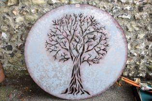 A tree of life garden wall display, 100cm wide.