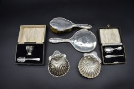 A quantity of silver,comprising: two cased christening sets; a silver hairbrush; a silver hand