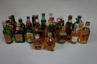 A collection of brandy and whisky miniatures, (levels good). (35)