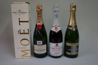 A 75cl bottle of Moet & Chandon NV champagne, in card box; together with another 75cl bottle of NV