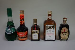 Five various bottles of liqueur, to include: an old 1 litre Gombar Triplice; and a 35cl