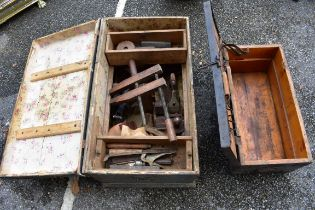 (LC) An old wooden trunk containing tools;together with a small wooden trunk.