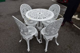 An aluminiumwhite painted garden table;together with four matching chairs.