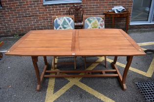 (LC) A hardwood garden table, 262cm extended;together with pair of matching chairs.