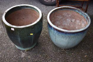 (LC) A pair of ceramic garden pots.