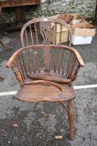 An antique Windsorarmchair,(a.f.).