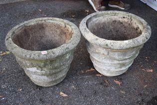 A pair of composition garden urns.