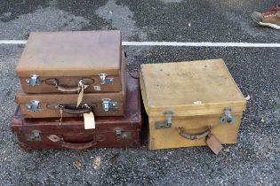 A velum suitcase;together with three other suitcases.
