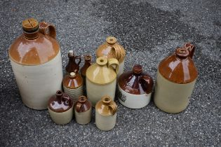 A quantity of stoneware bottles.