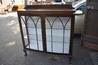 A 1920s mahogany bowfront display cabinet,119cm wide.