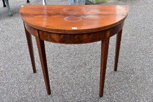 A George III mahogany demi lune card table.