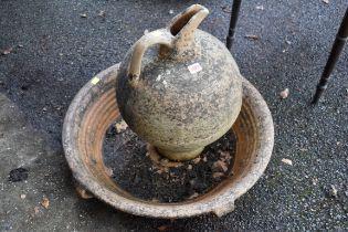 A terracotta garden jug,with matching base.