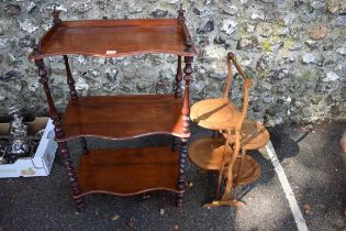 A Victorian mahogany three tier serpentine fronted whatnot; together with a cake stand.