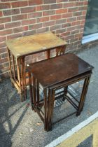 An antique nest of three tables;together with another nest of tables.