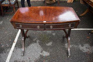 An antique mahogany bowfront sofa table,98cm wide x 59cm deep x 73cm high.