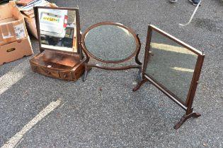 Three antique toilet mirrors.