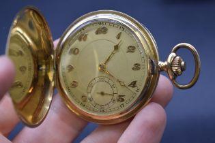 A vintage 14k engine turned gold stem wind pocket watch, 49mm.