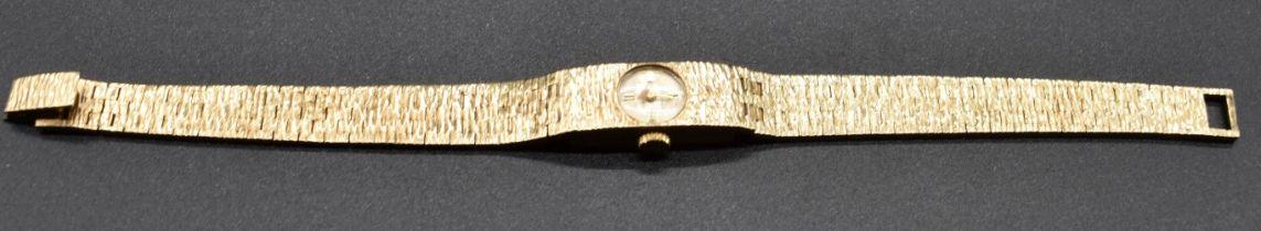 A vintage 9ct gold Accurist manual wind ladies bracelet watch, 22.2g.