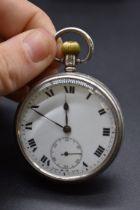 A silver open face stem wind pocket watch, 54mm.