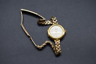 A Precista 18ct gold ladies quartz wristwatch,on an unmarked bracelet.