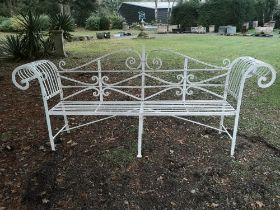 Garden seats: A Regency reeded wrought iron seat, early 19th century, 240cm wide