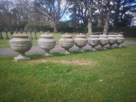 Garden pots and urns: A set of eight Neo-classical style composition stone finials possibly by